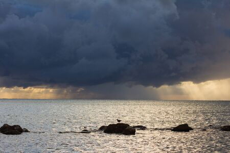 stormy waters: Dark stormy sea waters at morning Stock Photo