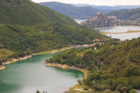 Impressive views of Turano lake with village Colle di Tora, Ital