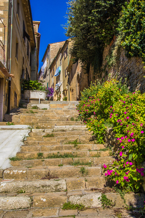 volterra: arrow Alley with Old Buildings in Italian City of Volterra Stock Photo