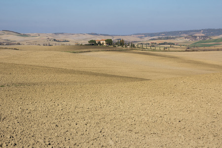 val d'orcia: Tuscany landscape with typical farm house on a hill in Val dOrcia, Italy.