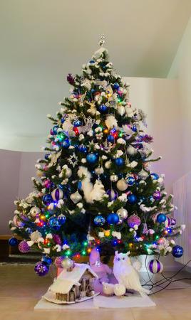 christmas tree decoration: Joyful studio shot of a Christmas tree with colorful decorations Stock Photo