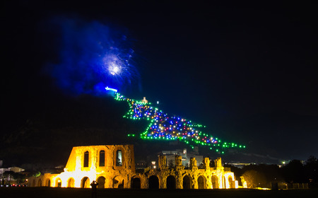 Whole city celebrating the New Year or any national event with fantastic blue firework. Photo of the famous christmas tree of Gubbio city in Umbria, Italy. Zdjęcie Seryjne - 50388687