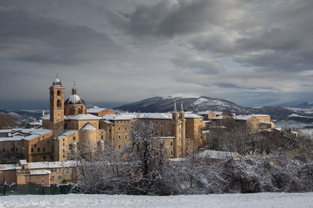 urbino: Winter card of Urbino with snow Editorial