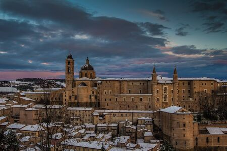urbino: Beautiful colored sky over Urbino at sunset with snow.