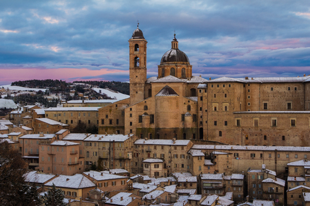 Photo of Urbino city covered by snow. Landmarks of Italy.