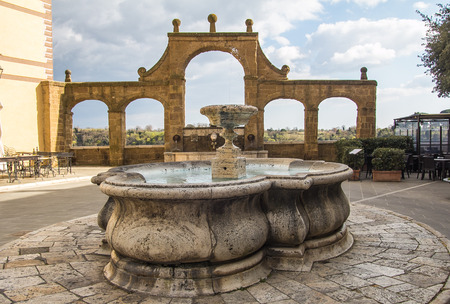 Ancient fountain on the historic center of Pitigliano village in Tuscany, Italy - HDR