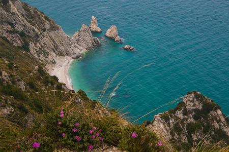 Beautiful view of two sisters cliffs (Spiaggia delle due sorelle), Mount Conero, Marche, Italy.