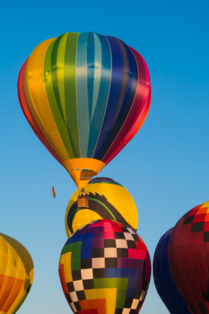 hotair: Colorful hot-air balloons flying in the blue sky Editorial