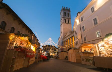 of assisi: ASSISI, ITALY - DECEMBER 16, 2016: Magic atmosphere with the christmas market in the historic center of Assisi