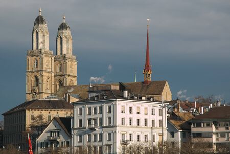 View of Grossmunster Church in Zurich old town, on the river side of Limmat Stock Photo