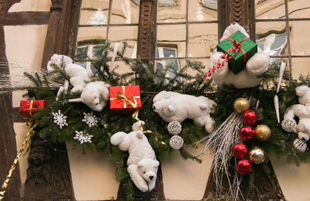 Detail of a traditional winter holidays decoration on a half-timbered house of Strasbourg. Christmas time in Alsace, France