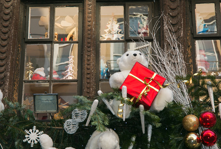 Winter decorations with white bear in medieval city of Strasbourg which is considered as a capital of Christmas