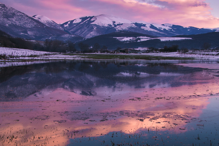 Romantic winter sunset on the puddle