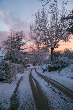 Scenic winter with road at sunset Stock Photo