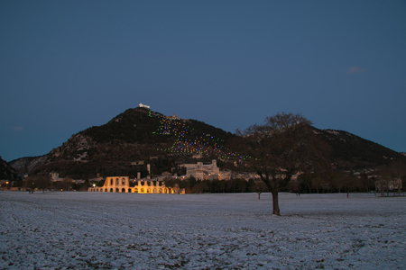 Winter view of Gubbio at night with snow