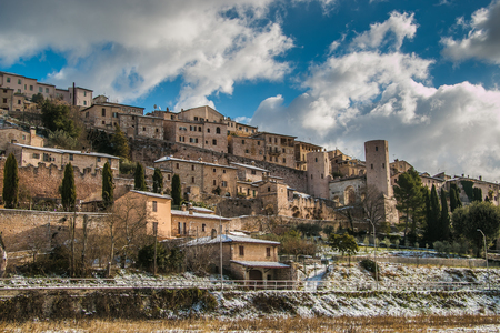 Beautiful view of Spello medieval village covered by snow - HDR Stock Photo