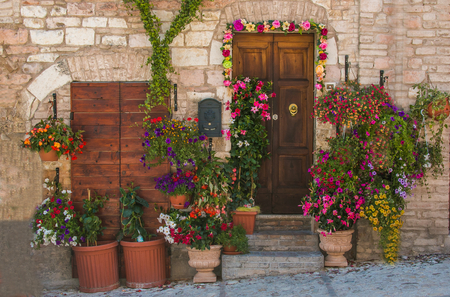 Colored entrance with pots of flowers, Spello Stock Photo