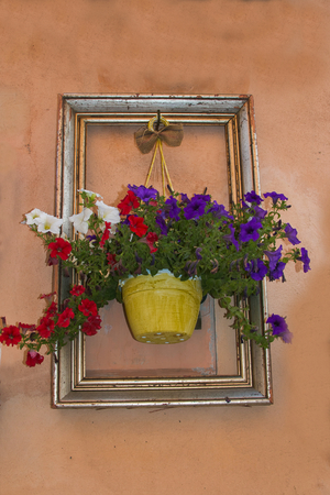 Frame with flower in the wall of Spello