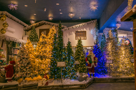 Interior of the reign of Santa Claus shop with christas trees, lights and decorations