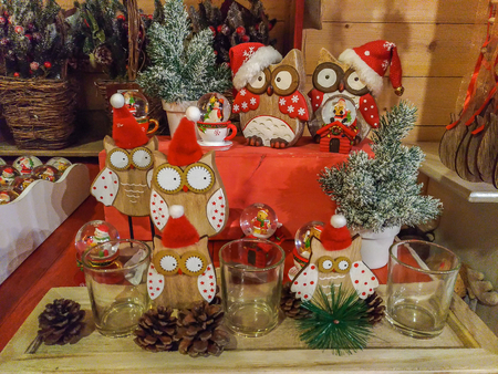 Pretty christmas owl with santa claus hat at christkindlmarkt of Merano
