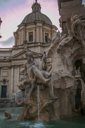 romantic places: View of the Fountain of the Four Rivers in Piazza Navona at sunset, Rome