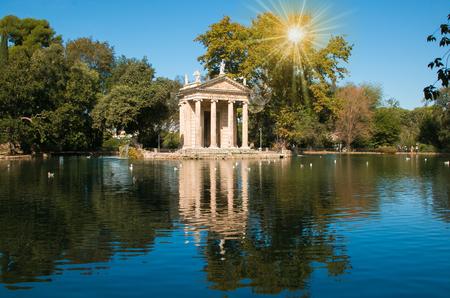 Temple of Esculapio at sunrise located at the beautiful garden of Villa Borghese, Rome, Italy Stock Photo
