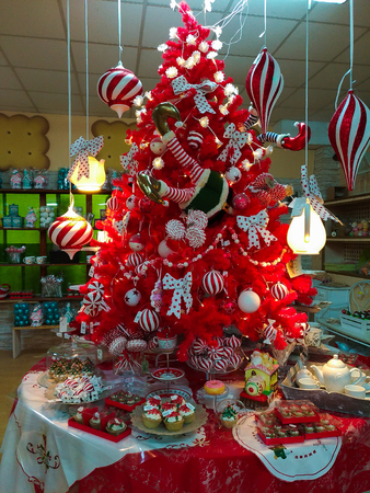 stock photo terni italy october 22 2017 red christmas tree with decorations at santa claus village shop in terni