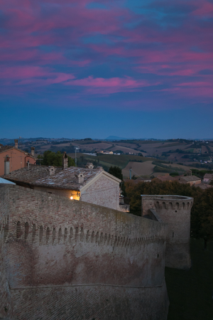 Romantic view of Corinaldo medieval village at sunset