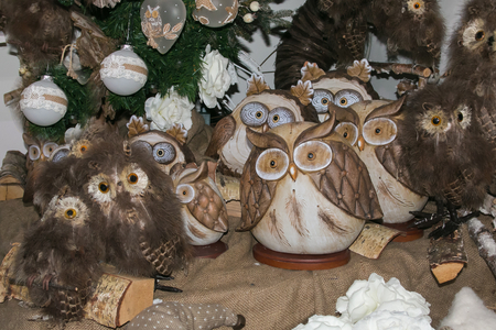 Wooden owls under Christmas tree Stock Photo