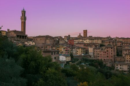 Romantic view of Siena medieval city at sunset, Tuscany, Italy