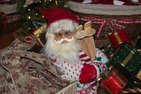 Beautiful Santa Claus with blue eyes and gift