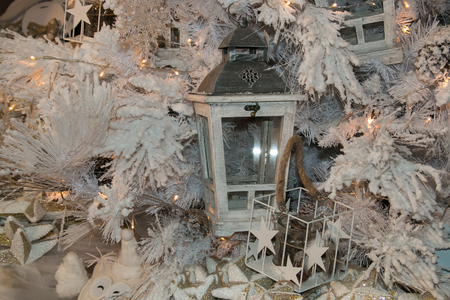 White christmas tree with lantern and lights