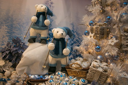 Winter landscape with polar bears skiing in the snow and Christmas tree with decorations