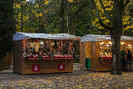 Beautiful Christmas market in the Acqua Santa Park of Chianciano Terme in the autumn season Stock Photo
