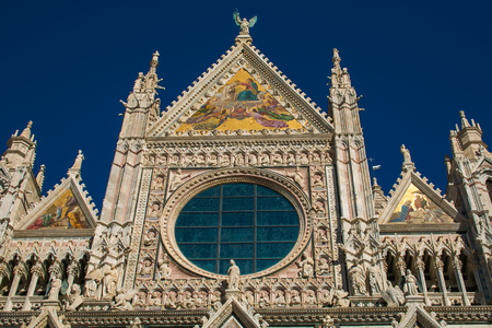 Detail of Siena cathedral against the blue sky
