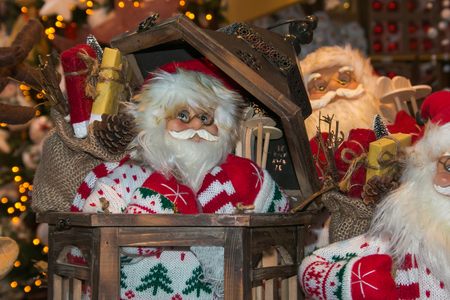 Portrait of Santa Claus toy with Christmas lights in the background