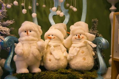 Three snowman on the chair