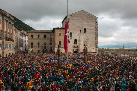 The famous festa dei ceri with many people in the historic center of Gubbio medieval village, Umbria