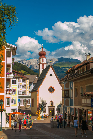 Square with Church of Saint Antonius in Ortisei, South Tyrol in northern Italy