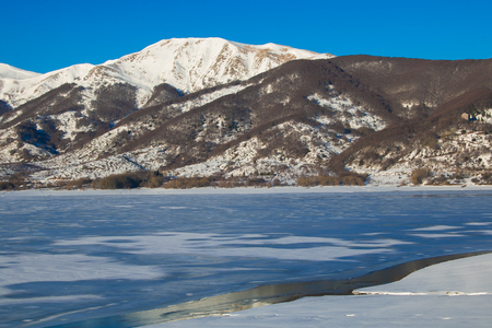 Save Download Preview Frozen dam of Campotosto on winter day