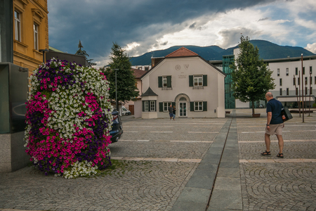 BRUNICO, ITALY - JULY 17, 2018: Flowers in the historic center of Brunico on summer day Editorial