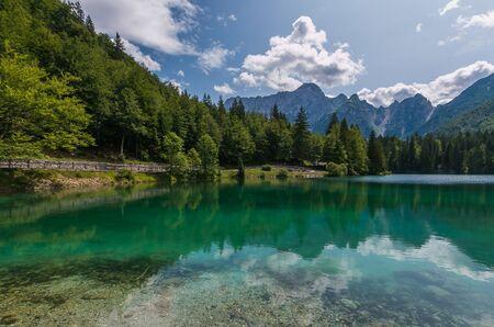 Stunning mountain landscape and hiking place. Spectacular superior Fusine lake and Mangart peak in background, Julian Alps, Tarvisio, Udine region, Friuli Venezia Giulia, Italy, Europe