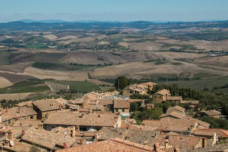 View of rooftops and hill of Montalcino in Tuscany, Italy
