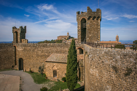 MONTALCINO, ITALY - OCTOBER 4, 2019: The Fortress of Montalcino is was built in 1381 by Domenico di Feo and Mino Foresi and incorporates part of the walls and towers of the previous century. The plant is pentagonal with slender corner towers irregular