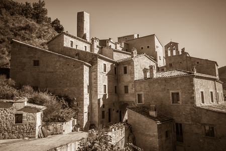 Sepia view of Postignano, an ancient medieval village in the heart of Valnerina in Umbria, brought back to life by an extraordinary restoration work
