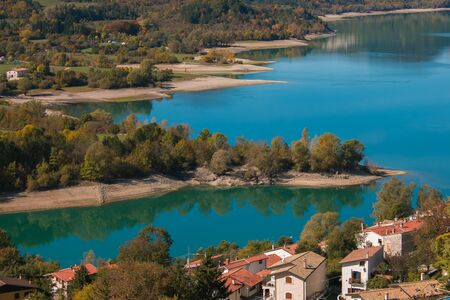 Beautiful view of Barrea lake and the mountain village in Abruzzo