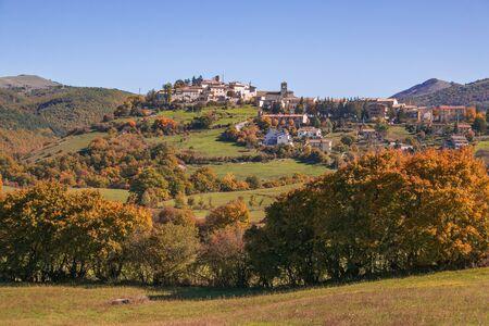 Panoramic view of Monteleone di Spoleto medieval village in the autumnal scenery