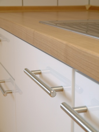 A modern kitchen  cabinet, counter top, sink  photo