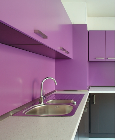 Newly fitted modern kitchen in purple and brown