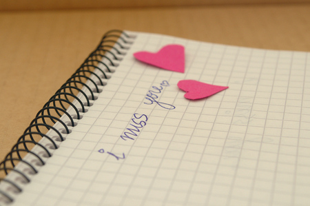 I miss you word on note book